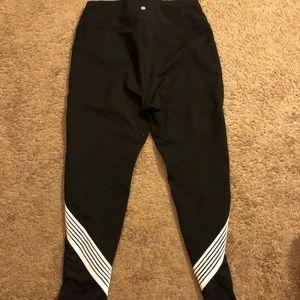Black leggings w/ white stripes